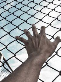 hand-jail-freedom